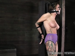 Boobylicious blond whore with a gag in her face hole is tortured