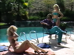 Two smokin' hot golden-haired chicks give lesbo show over the pool