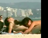 Two stunning non-professional lesbo beauties on the nudist beach