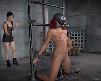Ebony BBC slut with dyed hair standing on her knees is punished