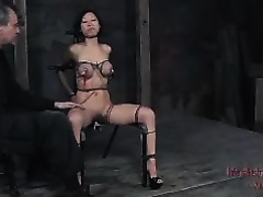 Lovely Asian slave with large pointer sisters is tortured and toyed