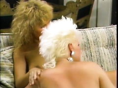 Two carnal golden-haired lesbian babes please each other in 69 position