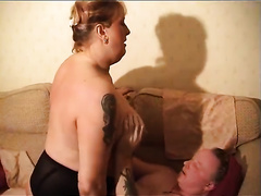 Bosomy BBW whore with tattoos straddles her paramour on top