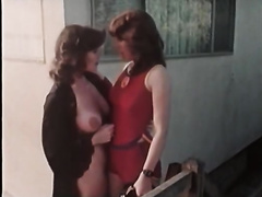 Attractive lesbo ladies take up with the tongue their muffs outdoors