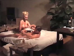 My breasty wife rubs warm massage oil all over my dick in a hot way
