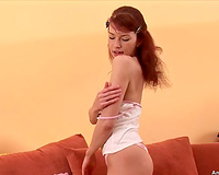 Horny redhead puts on a precious striptease show and then masturbates