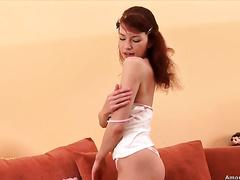 Horny redhead puts on a precious striptease show and then masturbates