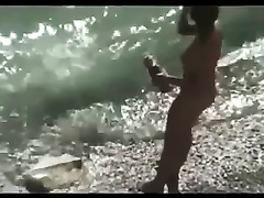Cute and skinny girl on the nudist beach is in the mood for oral sex