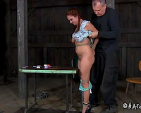 Pigtailed redhead with biggest mounds is tied hand and foot