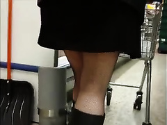 Hidden camera upskirt video with a milf wearing nylons