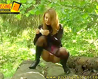 Blonde cutie takes her tights off to piss outdoors