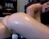 Bosomy sweetheart shows her oiled butt and rubs her vagina with a sex tool