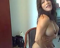 Sporty web camera model is very proud of her large milk sacks and butt