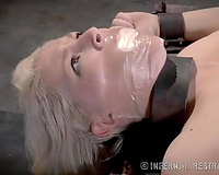 Poor blond playgirl with pale skin is tortured with wax