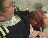 Nerdy old stud acquires his pecker sucked by a redhead whore in a crap-house