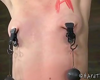 Crucified blonde babe with great slender body got enormous clamps on her meatballs