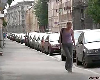 Here is a nerdy Russian blond chick walking in the park and pissing