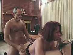 Redhead milf blows and enjoys it from behind in Male+Male+Female movie