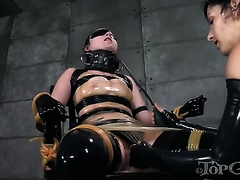 Blindfolded brunette sweetie is restrained by her hot mistress