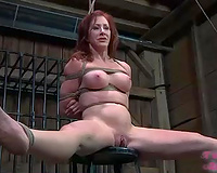Perverted redhead with large moist mounds is tied hand and foot