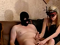 Masked blonde hottie favours her masked paramour with a tugjob
