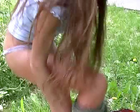 Skinny non-professional Russian playgirl behind the car voids urine in her panties