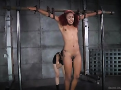 Ebony hotwife with dyed hair is bounded and tortured by her dominatrix