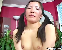 Pale skin Korean girl on the table masturbates and squirts