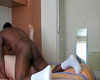 Fucking a golden-haired BBW's vagina in interracial homemade movie