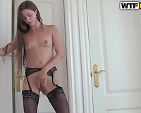 Long-haired beauty wearing stockins shows her body in solo scene