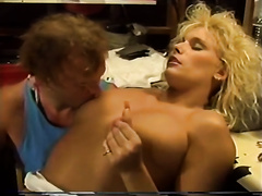 Retro golden-haired mamma favours a man with a fellatio in a workshop