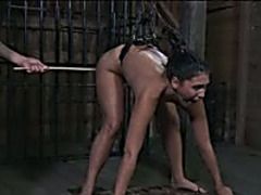 Jade receives beaten with a stick and fucked from behind in BDSM movie