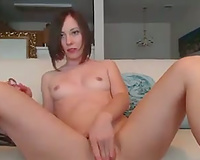 Webcam performance with redhead enchantress fucking her vag with toy