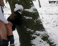 Ardent rear banging scene in the cold winter forest