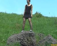 Stupid brunette hair floozy in nylons voids urine from a pedestal
