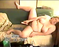 big beautiful woman breasty white cheating wife on the daybed fondles herself with a stick
