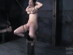 Kinky whore acquires pulled by the nipples and whipped in BDSM scene