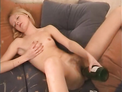 Astonishing golden-haired babe shoves her shaggy cunny with a bottle