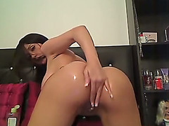 Delightfully hot gal with large love muffins fucks her arse with her glass sex toy