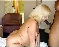 Blonde curvy aged lady obediently blows my large dark 10-Pounder