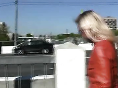 Depraved blond Irina pees her pants in a public place