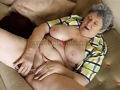 Grey haired big beautiful woman granny masturbates with sextoy on bed