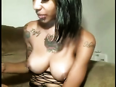 Classy ebony nympho with tattoos loves to play with different sex toys