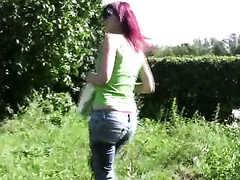 Redhead Russian freak drives to the town center to pee in her panties