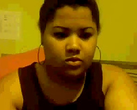 Chubby mulatto playgirl sucks her fingers and fondles her big tits