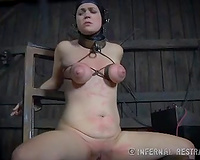 Bosomy sweetheart with fastened boobs wearing a leather helmet tortured in the barn