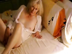 Sensual blond granny entertains herself by fingering her cum-hole