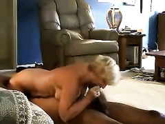 Busty older blond cheating wife in interracial fuck with a dark dude