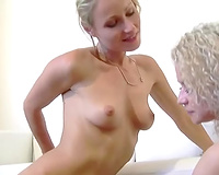 Horny blond copulates her lesbo GF with a curved sextoy