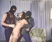 Sensual curly brunette hair gets her cookie touched by 2 masked fellows